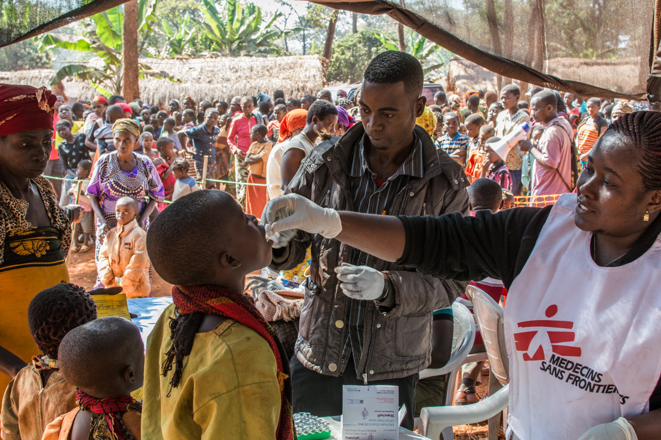 MSF Staff administrate an oral vaccine to a boy at the Nyaragusu refugee camp.