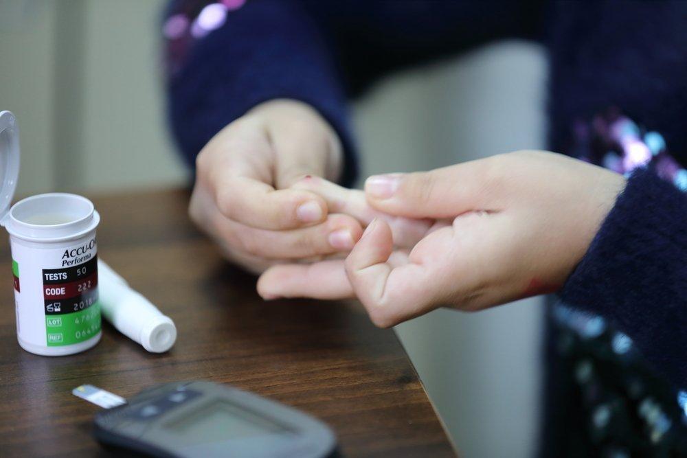 A diabetic patient checks blood sugar levels.