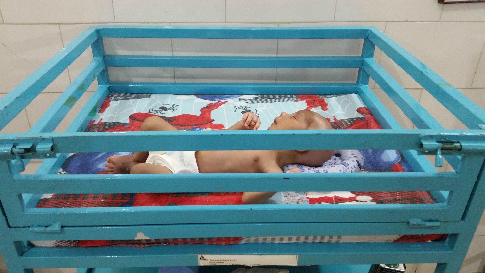 Baby Shahida in her cot