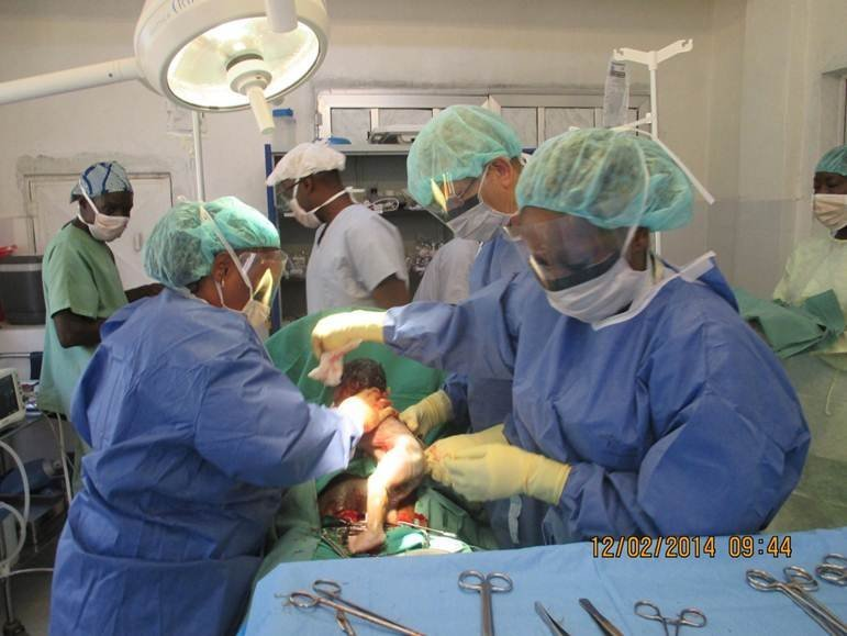 Steve and the MSF team perform a caesarean section on a new mother.