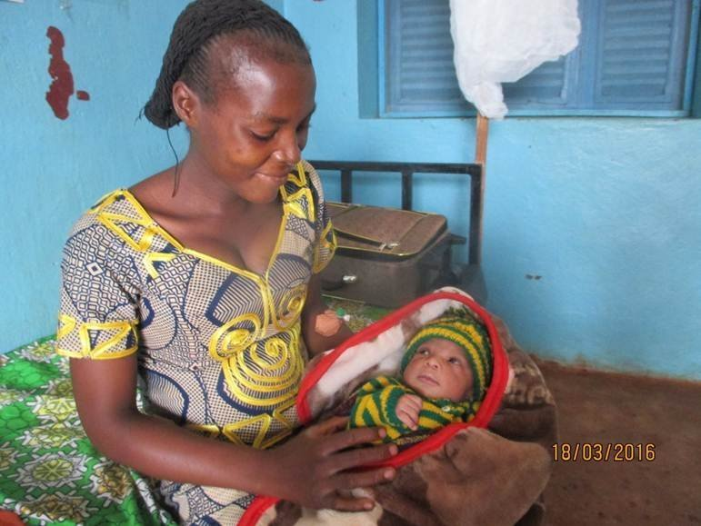Proud new mama at MSF's emergency hospital in Bangui, Central African Republic.