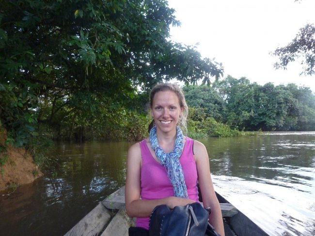 Katy crossing the border between Guinea and Liberia in a dugout canoe.
