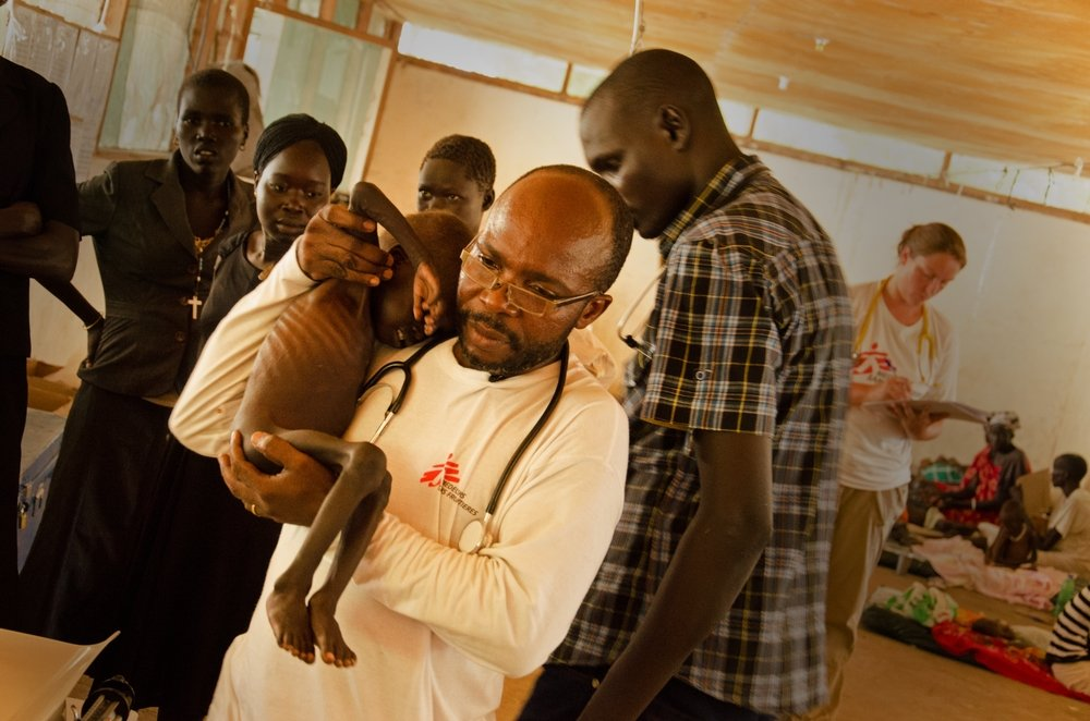 MSF nurtrition nurse Charles Mpona Kalinde attends to severely malnourished two-year-old Gatluok in Leer, South Sudan.