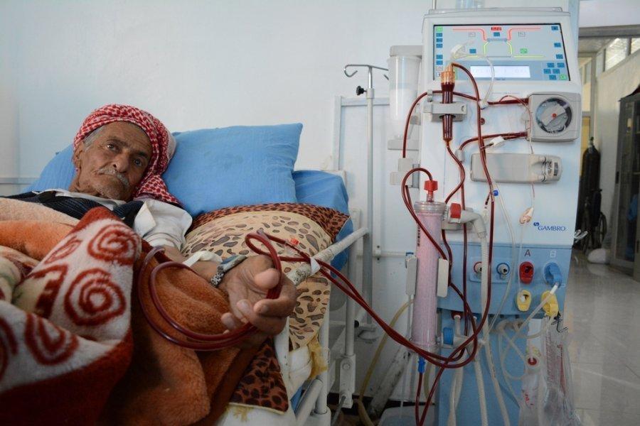 A man undergoes dialysis in Al-Jumhori hospital in Sana'a. May 2016.