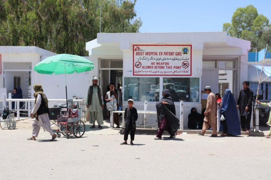 People in front of the main gate of MSF's Boost Hospital.