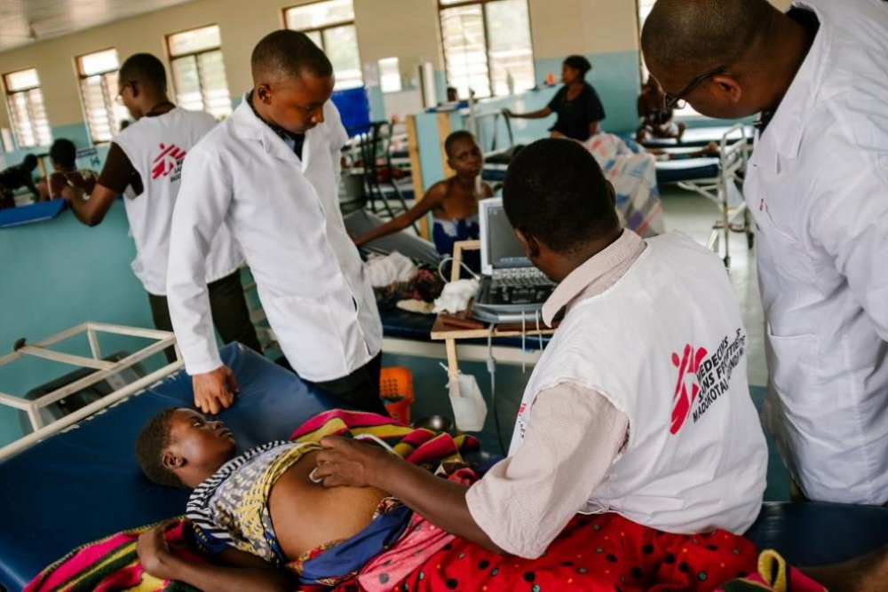MSF staff examine a patient with advanced HIV at Nsanje district hospital, Malawi.