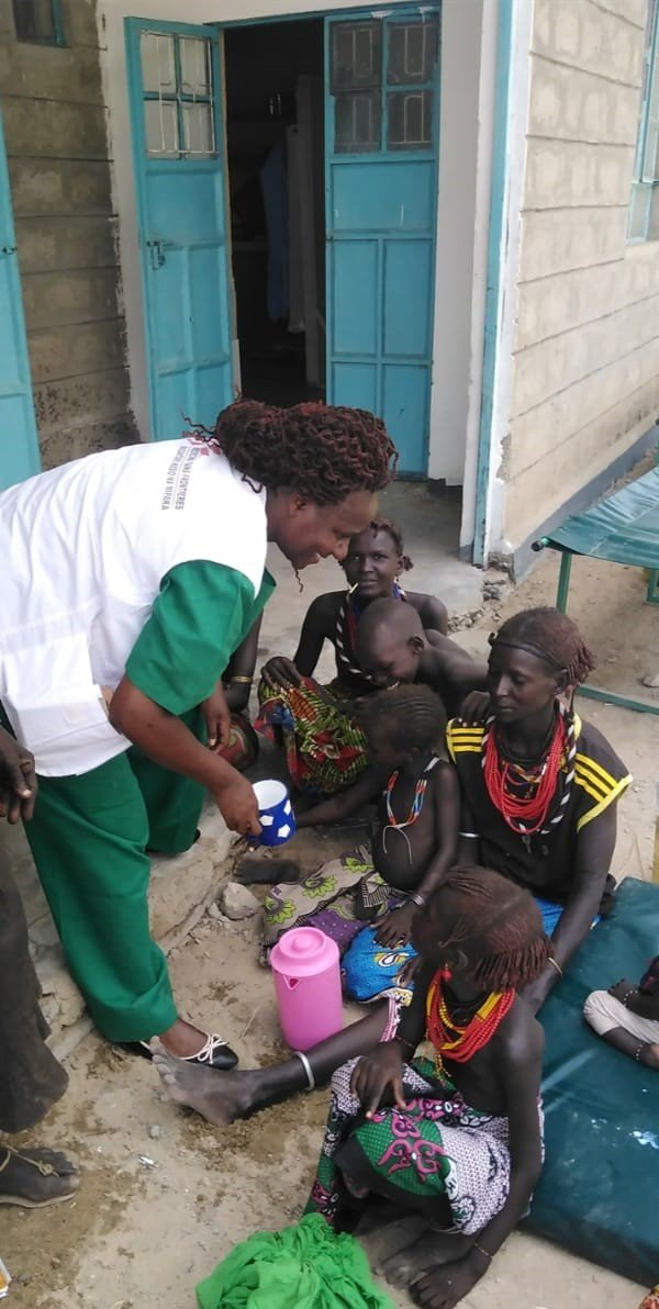 Penina , a nurse demonstrates to a family how to prepare Oral Rehydration Solution (ORS), for oral rehydration sufficient to treat mild cases following discharge