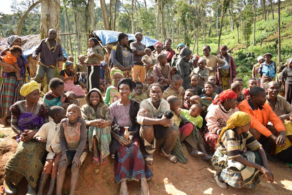 A group of internally displaced people gather in a makeshift camp in Katasomwa, in the Kalehe Territory of South Kivu. Democratic Republic of Congo, November 2020.