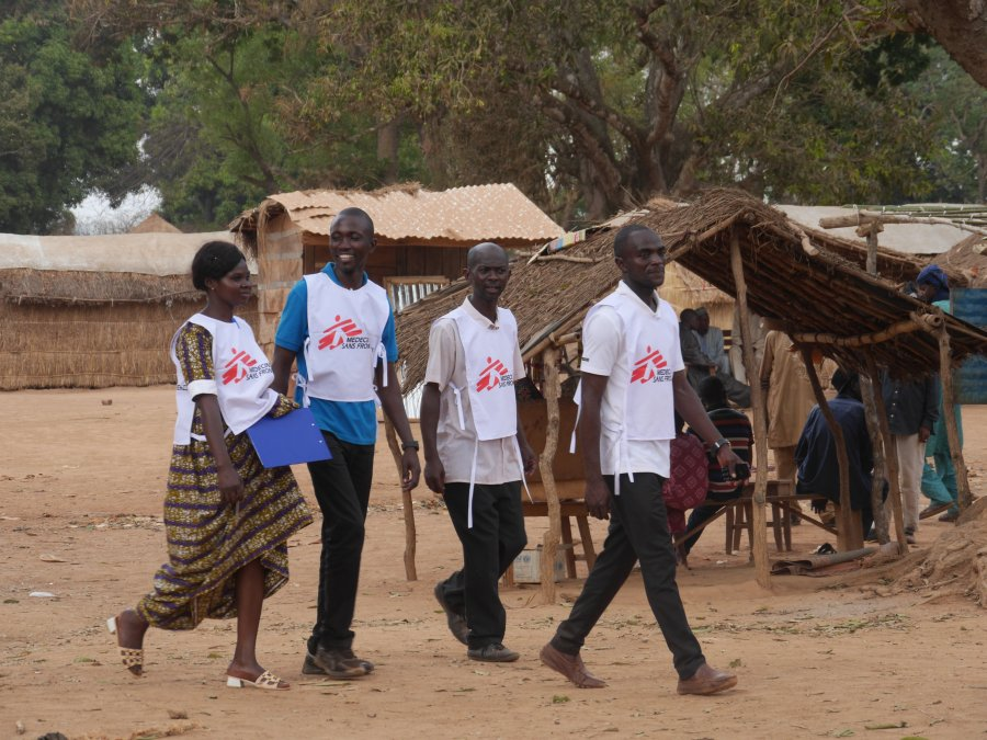 MSF surveyors walk through a village in the prefecture of Ouaka, Central African Republic, as part of a MSF healthcare study in 2020.