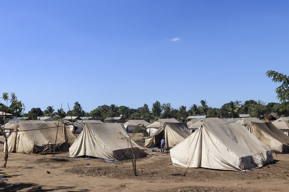 Tents have been supplied by multiple organizations to provide shelter just part of the thousands displaced people knowing struggling to live in Metuge. Up to 15 people are living, crammed together in the tents. Others have had to build their own shelters