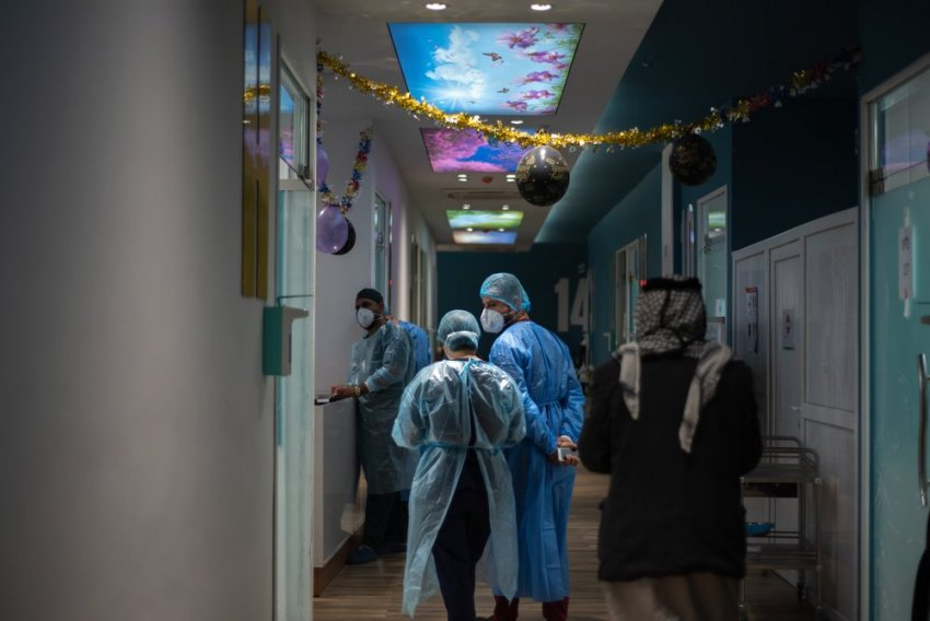 MSF nurses wearing personal protective equipment and touring on patients at the MSF run inpatient ward of the Al-Shifaa 13 COVID-19 ward in Al-Kindi Hospital, Baghdad.