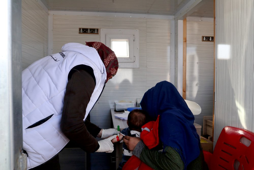 On February 17, 2020, a displaced Syrian woman is getting her son screened for malnutrition at the MSF mobile clinic in Qadimoon camp (Northwest Syria).