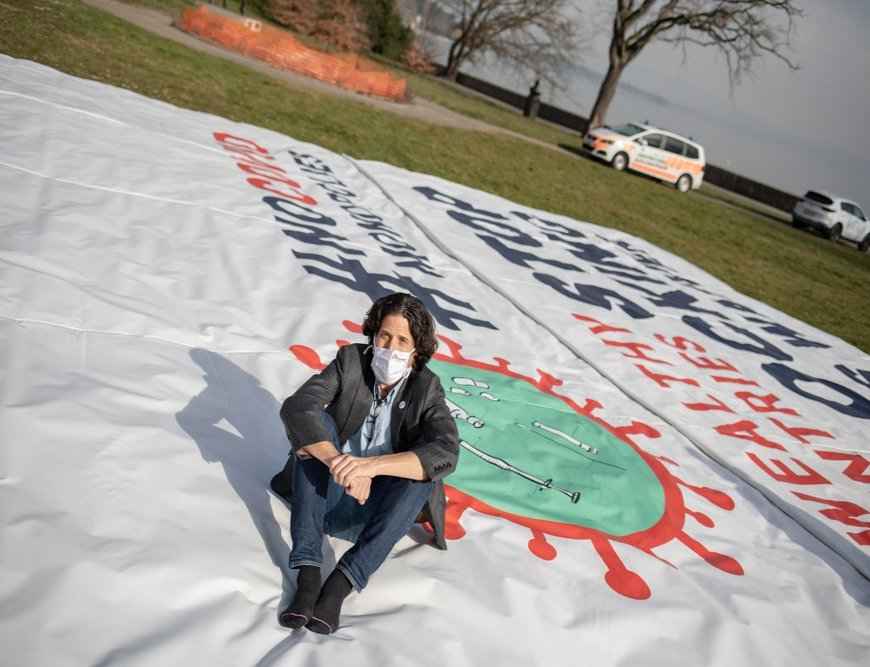 Stephen Cornish, General Director  of MSF operational center of Geneva, sitting on the banner deployed by MSF in front of the World Trade Organization (WTO) in Geneva calling on certain governments to stop blocking the landmark waiver proposal.