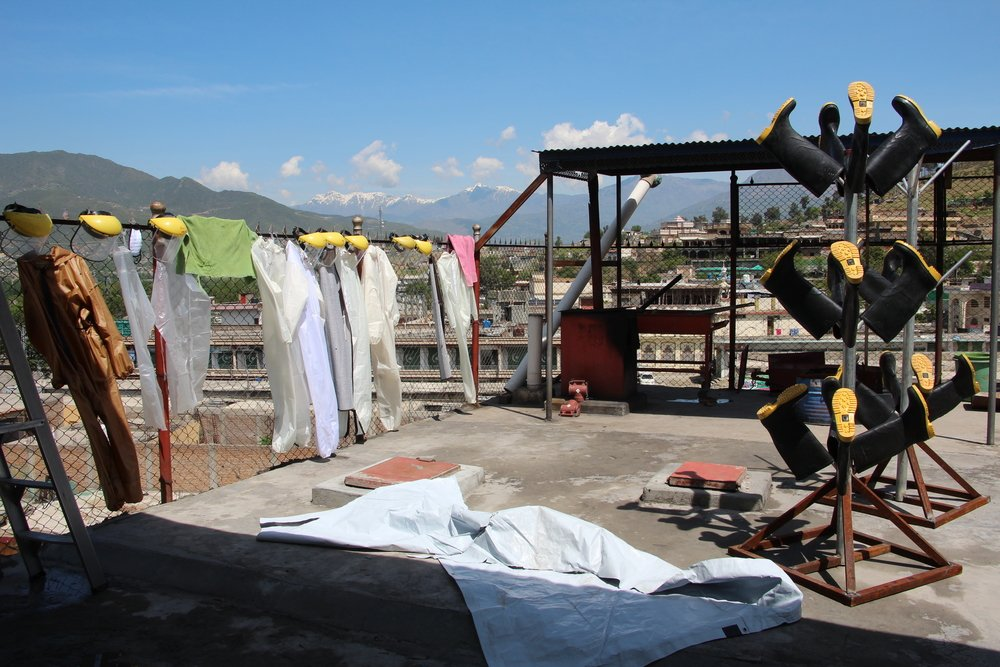 A view of the temporary drying area for the reusable protective equipment at Timergara DHQ hospital. The screening and triage was installed in just 7 days, and now the team is working on setting up a dedicated drying area for the for the reusable protecti