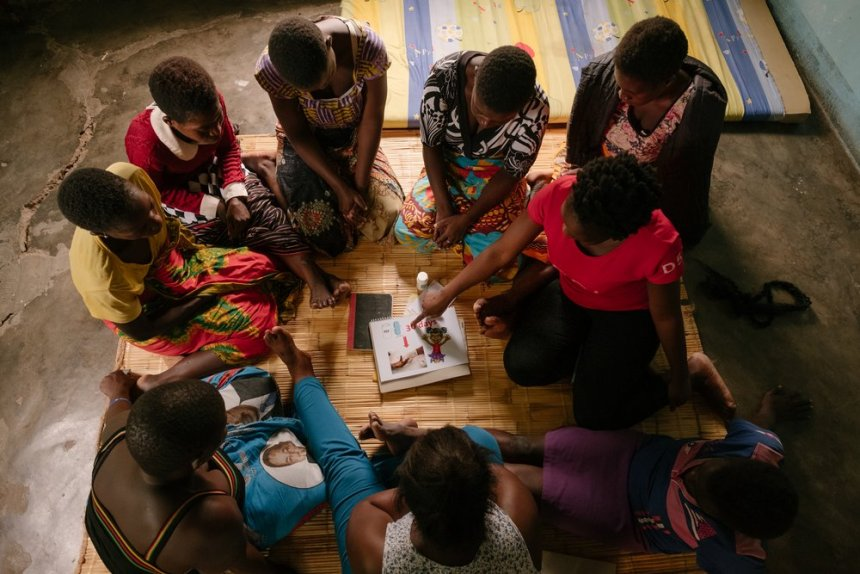 An MSF community health worker Adeline (not her real name) conducts a health promotion session with a sex worker community ART group.