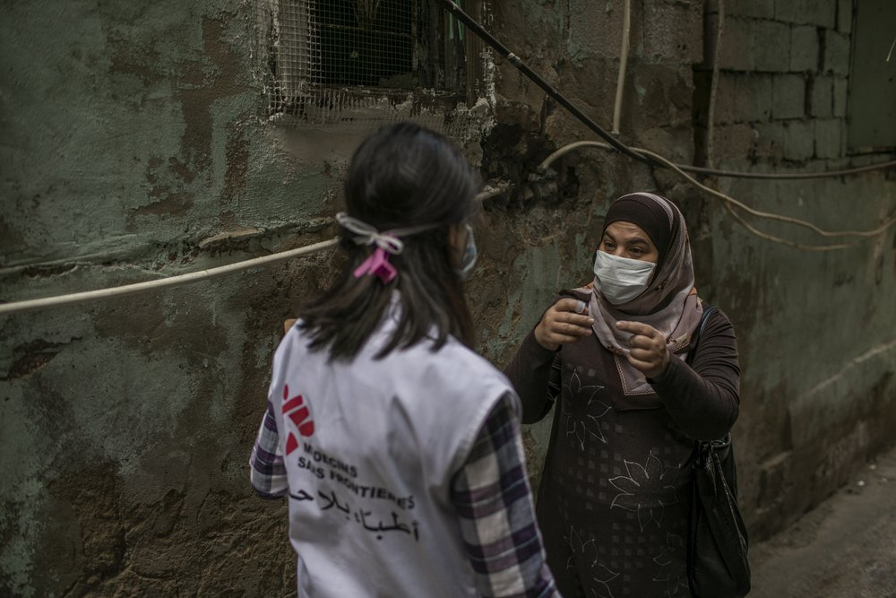 "Dayana Tabbarah, MSF health promoter, in the streets of Burj al-Barajneh camp, Beirut. ""Talking to people in the streets and listening to their medical concerns has changed since the beginning of the COVID-19 pandemic."