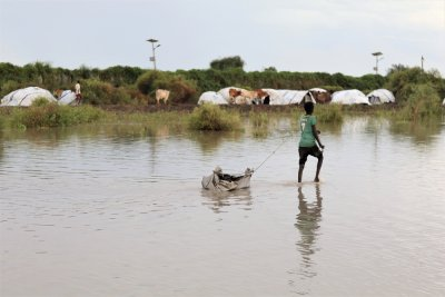 A boy walks on flooded airstrip in Pibor Town, the Greater Pibor Administrative Area, South Sudan.