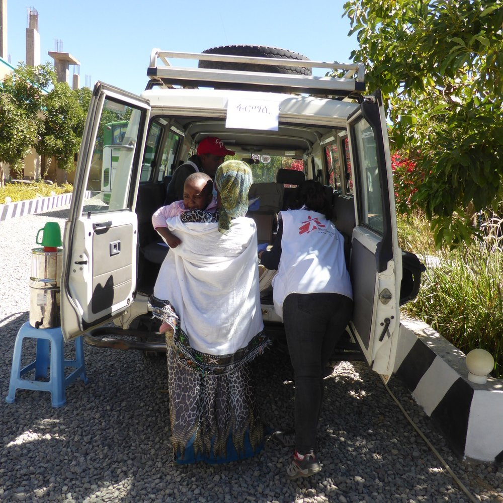 MSF staff transport a patient during a mobile clinic in Hawzen, northeast Tigray.