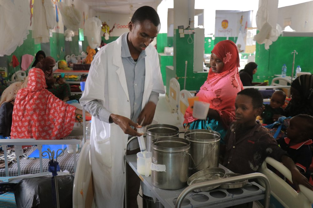 A male nurse is prepares milk for malnourished children in the therapeutic feeding centre at Mudug Regional Hospital in Galkayo city, in the Mudug region of Somalia.