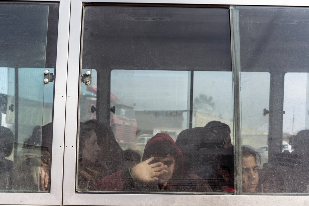 Iraq. Sahela Border Crossing. November 1, 2019. Newly arrived Syrian-Kurdish refugees aboard a bus operated by the International Organization of Migration (IOM). Buses transport the newly arrived refugees from the Sahela Iraq-Syria border crossing in Iraq