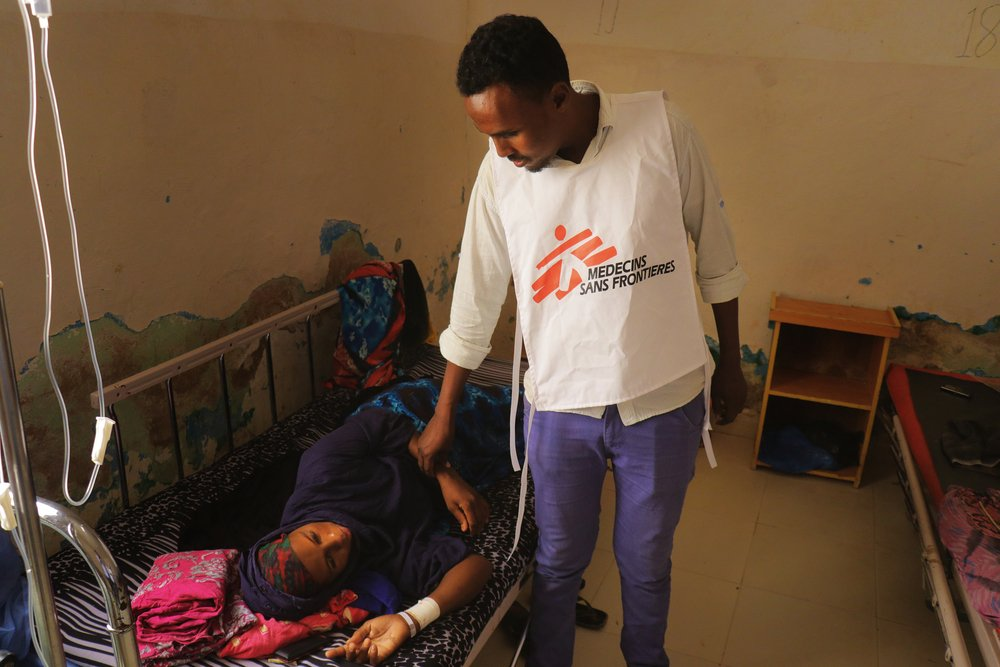 Dr Abdullahi Mohamed Muse, medical doctor in the at Mudug Regional Hospital maternity ward in Galkayo city, Somalia, checks the condition of Deqa Awil Hassan, a woman who had a Caesarean-section.