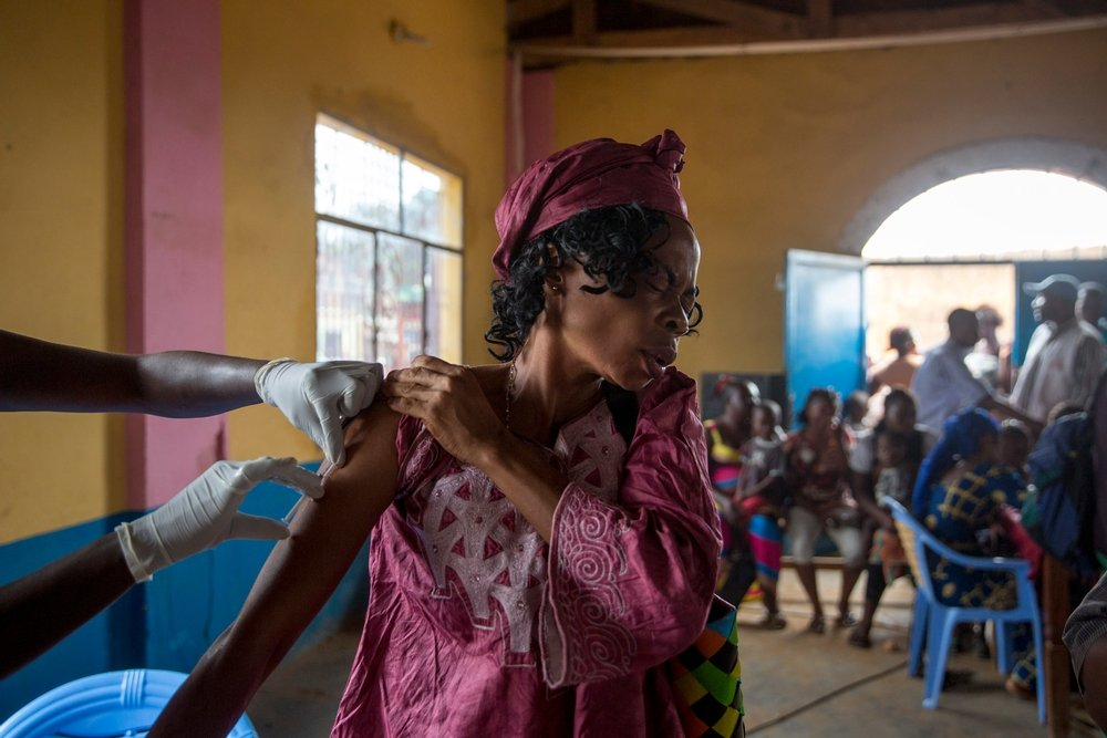 A woman is vaccinated against yellow fever by A Medecins Sans Frontieres (MSF) health worker in Matadi, Democratic Republic of Congo