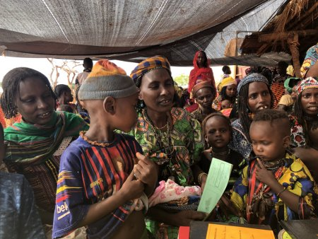 Mothers and children in Mingala, an area that is difficult to access due to insecurity and bad road conditions, during a two-day MSF vaccination programme. Central African Republic, March 2019.