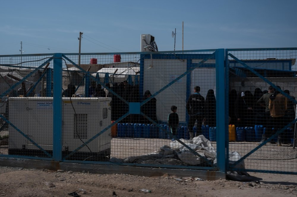 People queuing for water in Al-Hol Camp, Eastern Al-Hasakah Governorate, Northeastern Syria.