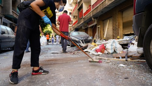 A young volunteer helping in cleaning up debris and shuttered glass from the streets of Achrafieh neighborhood of Beirut.