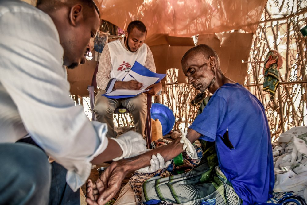 A patient with cancer of the oesophagus is cared for through MSF's palliative care programme in Dagahaley, part of Dadaab refugee camp. Kenya, November 2019.