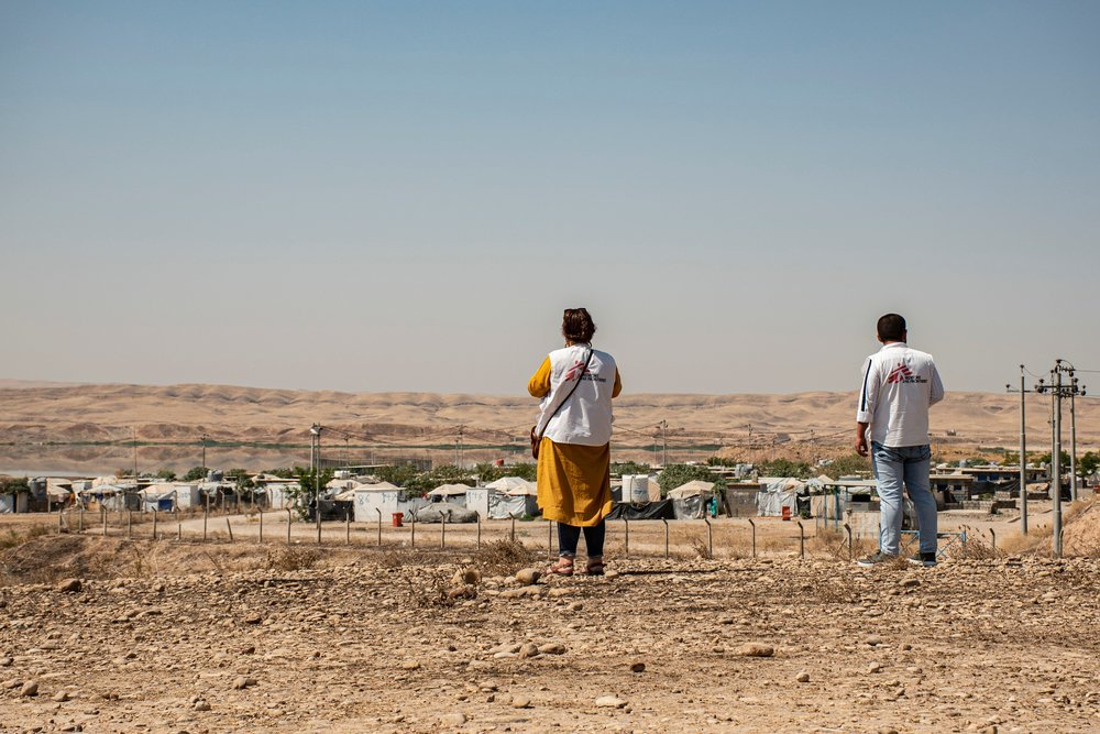 MSF staff near Alwand 2 camp in the Khanaqin district of Diyala governorate. Many people displaced from different regions have been living in the camp for years. Iraq, August 2019.