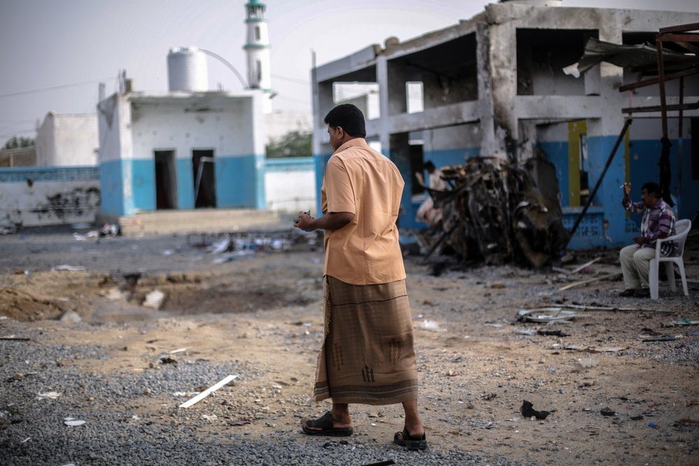 A local journalist surveys the damage caused by the Saudi-led coalition airstrike that hit our hospital in Abs on 15 August 2016.