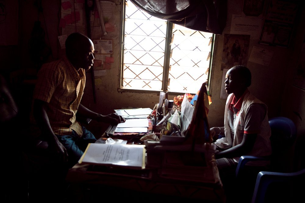 Étienne Oumba talks with Nadia, a community agent from MSF, in his office in Bangui, CAR, on 11th December 2020. Among the 3,000 victims of sexual violence he has identified so far, 700 are women.