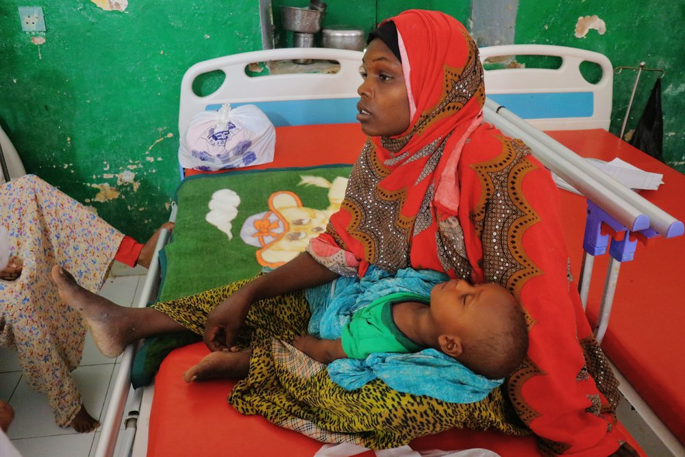 25-year-old Kawsar Ibrahim Osman holds her eight-month-old child, Bilal, in the inpatient therapeutic feeding centre at Mudug Regional Hospital, in Galkayo city, Mudug region, Somalia.