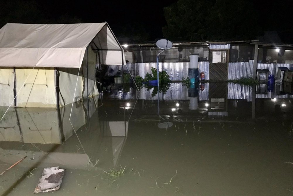Rising waters in MSF's primary healthcare centre and compound in Pibor town