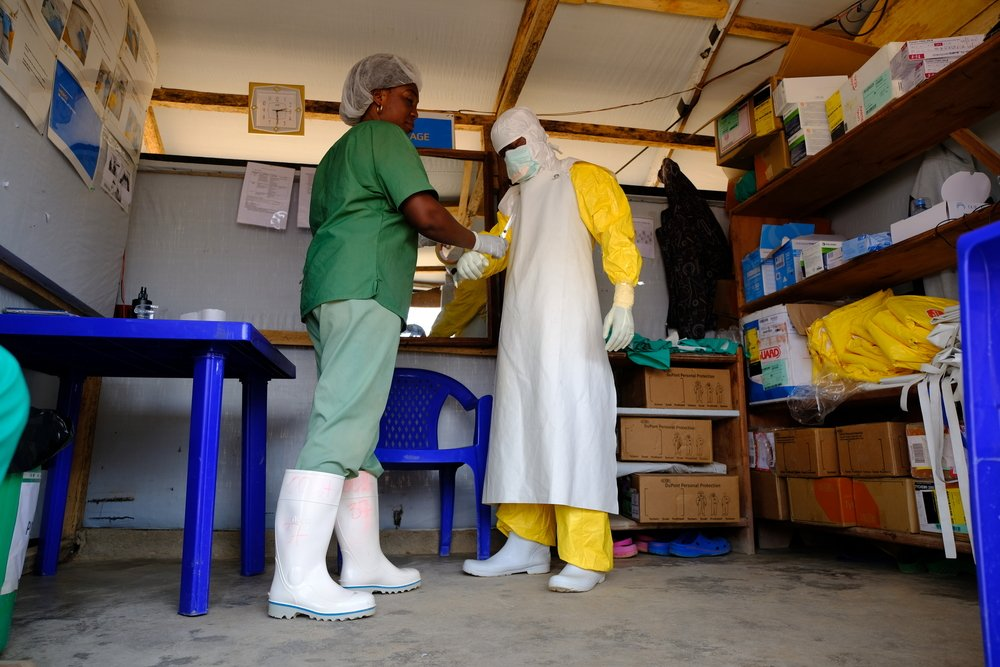 A staff member prepares to enter the high-risk zone at the Ebola Treatment Center in Beni.