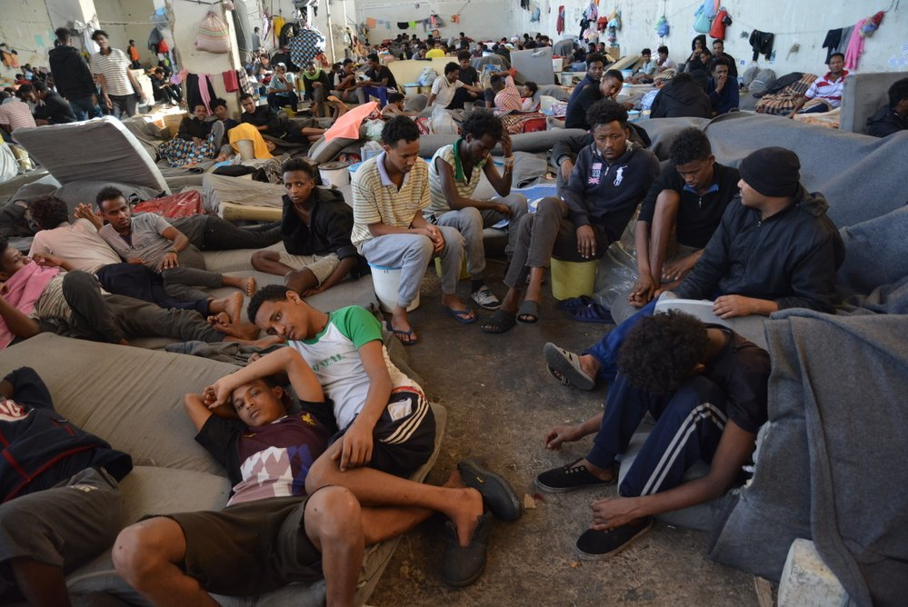 Some of the 700 refugees detained in the main warehouse of Zintan detention centre. In June 2019, the detainees were distributed among other buildings within the compound. Libya, July 2019.