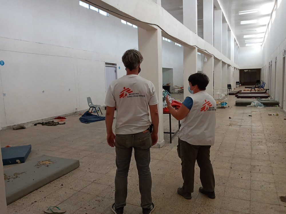 Two MSF staff inspect a room that will be converted into a hospital ward in Adigrat, in Tigray, northern Ethiopia.