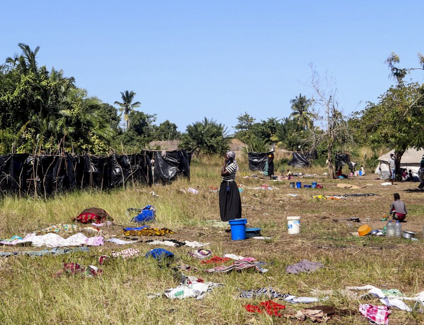 A woman stands in field where clothes are dried after washing in Metuge, Cabo Delgado Province. Make shift displace person camps have formed after a series of attacks has forced thousands to flee the north region.Metuge