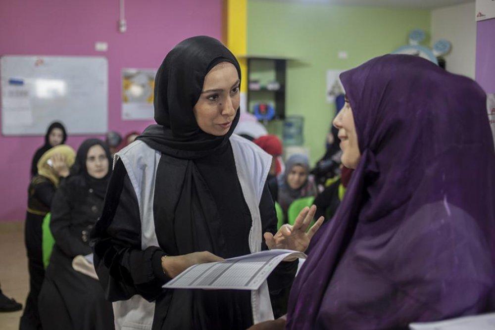 Wafaa Sharif working at the maternity ward in Burj al-Barajneh